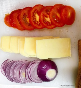 Sliced onions, cheese and tomatoes