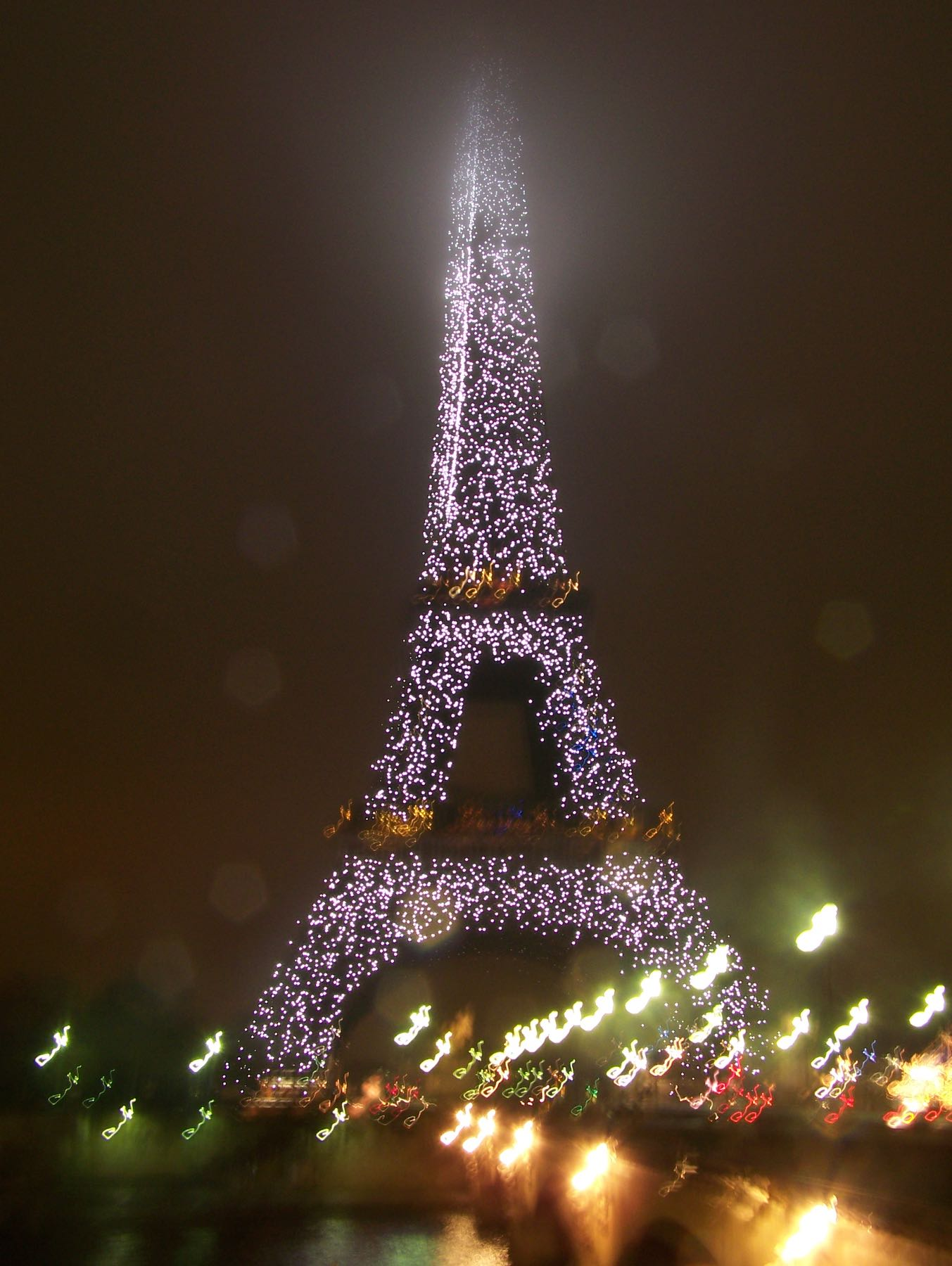 Eiffel tower in Paris at night with lights