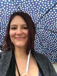 Me with my polkadot umbrella in the rain in Vienna