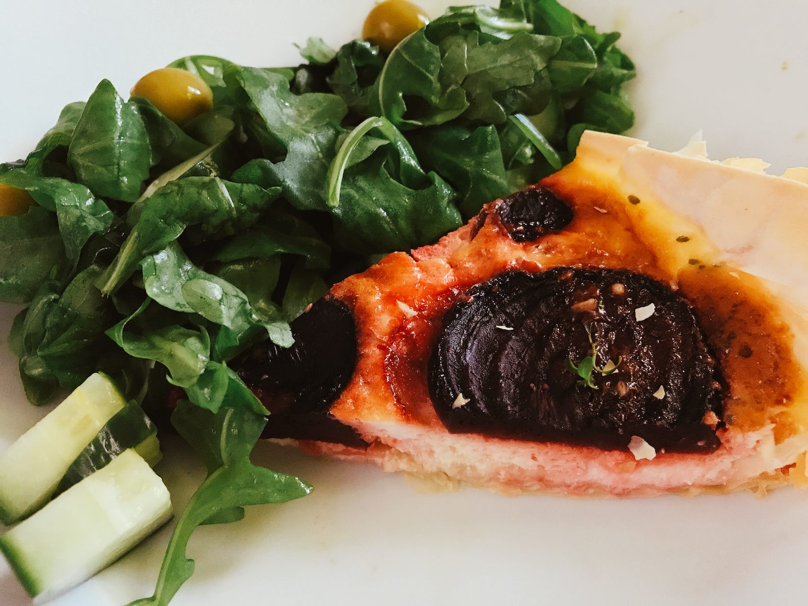 Beetroot quiche slice with salad