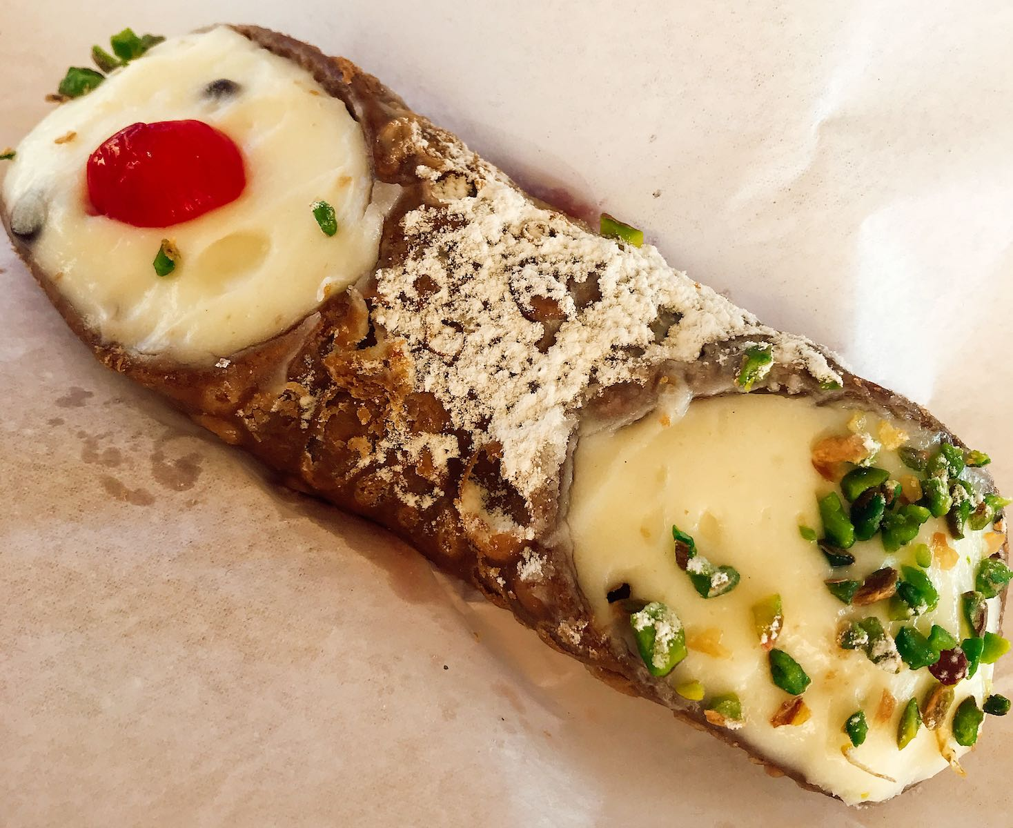 Cannoli with pistachio and cherry
