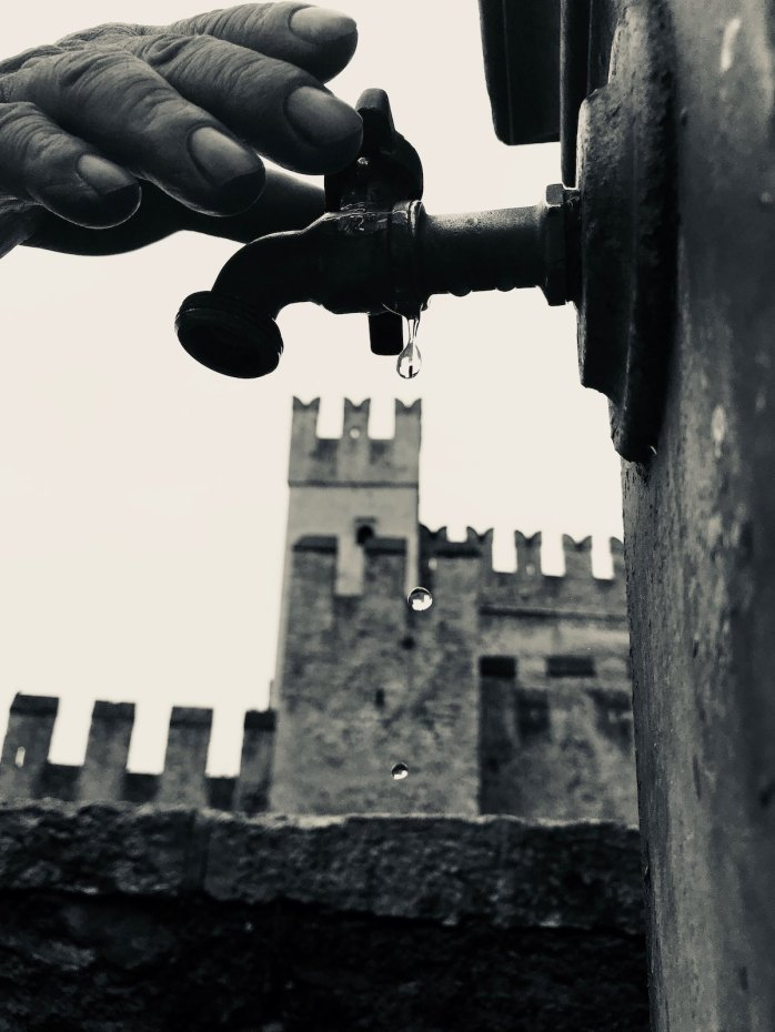 Hand on tap outside Sirmione Castle