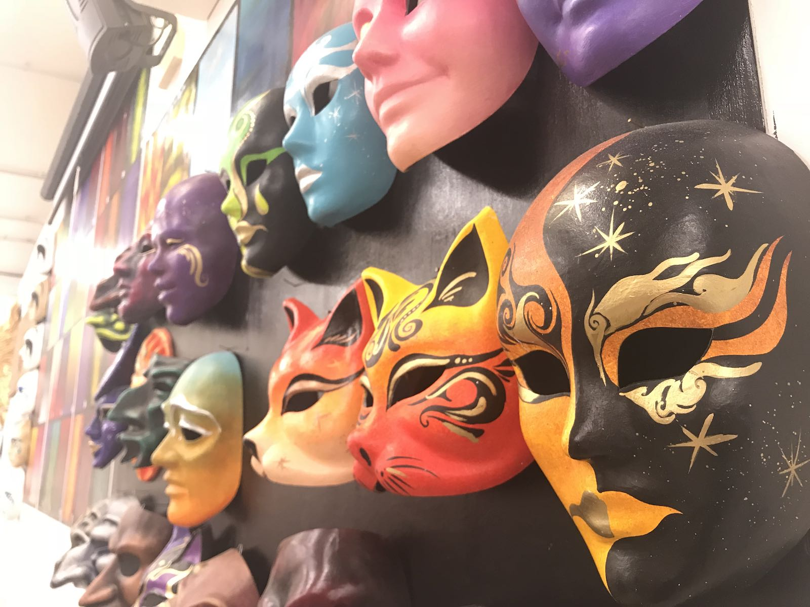 Masks on the wall at the studio