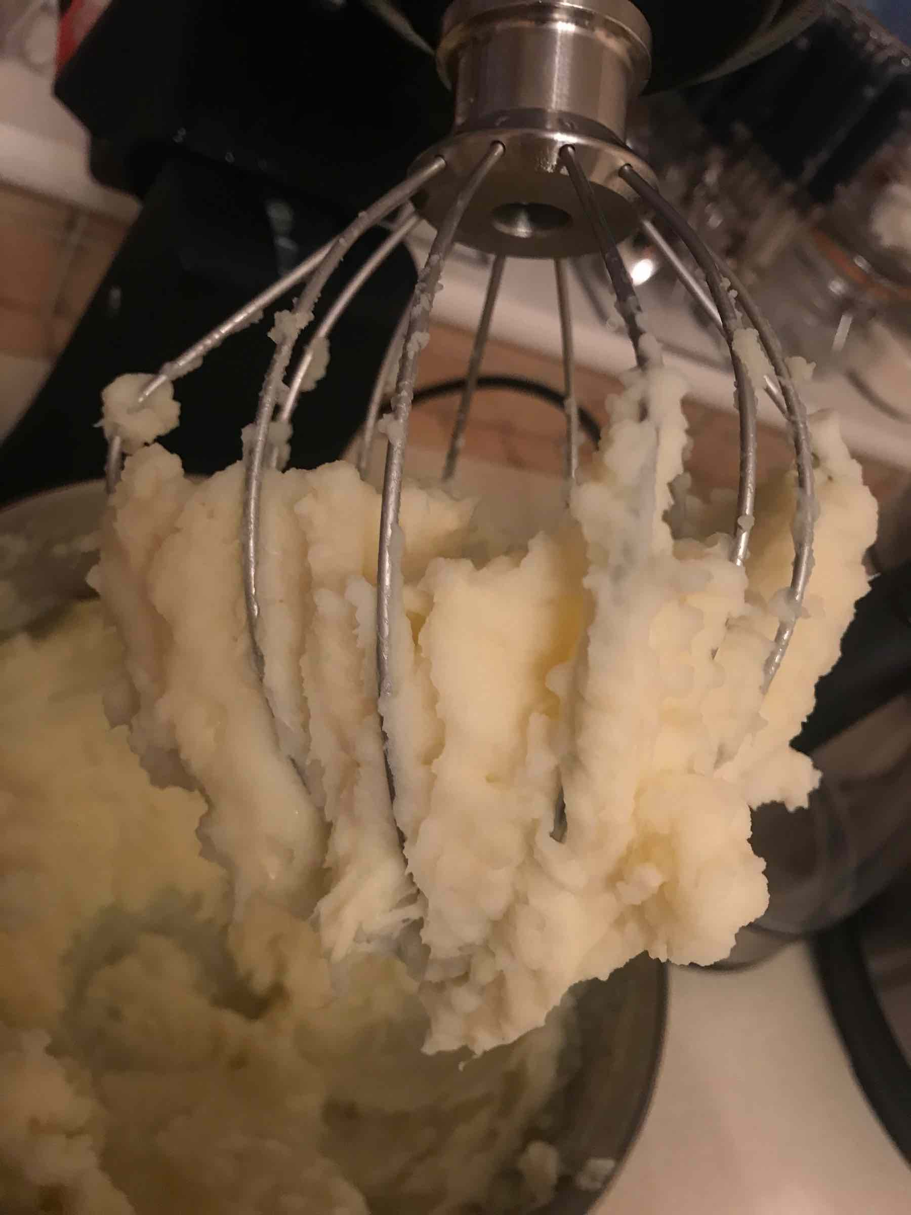 Mashed potatoes stuck to a balloon whisk
