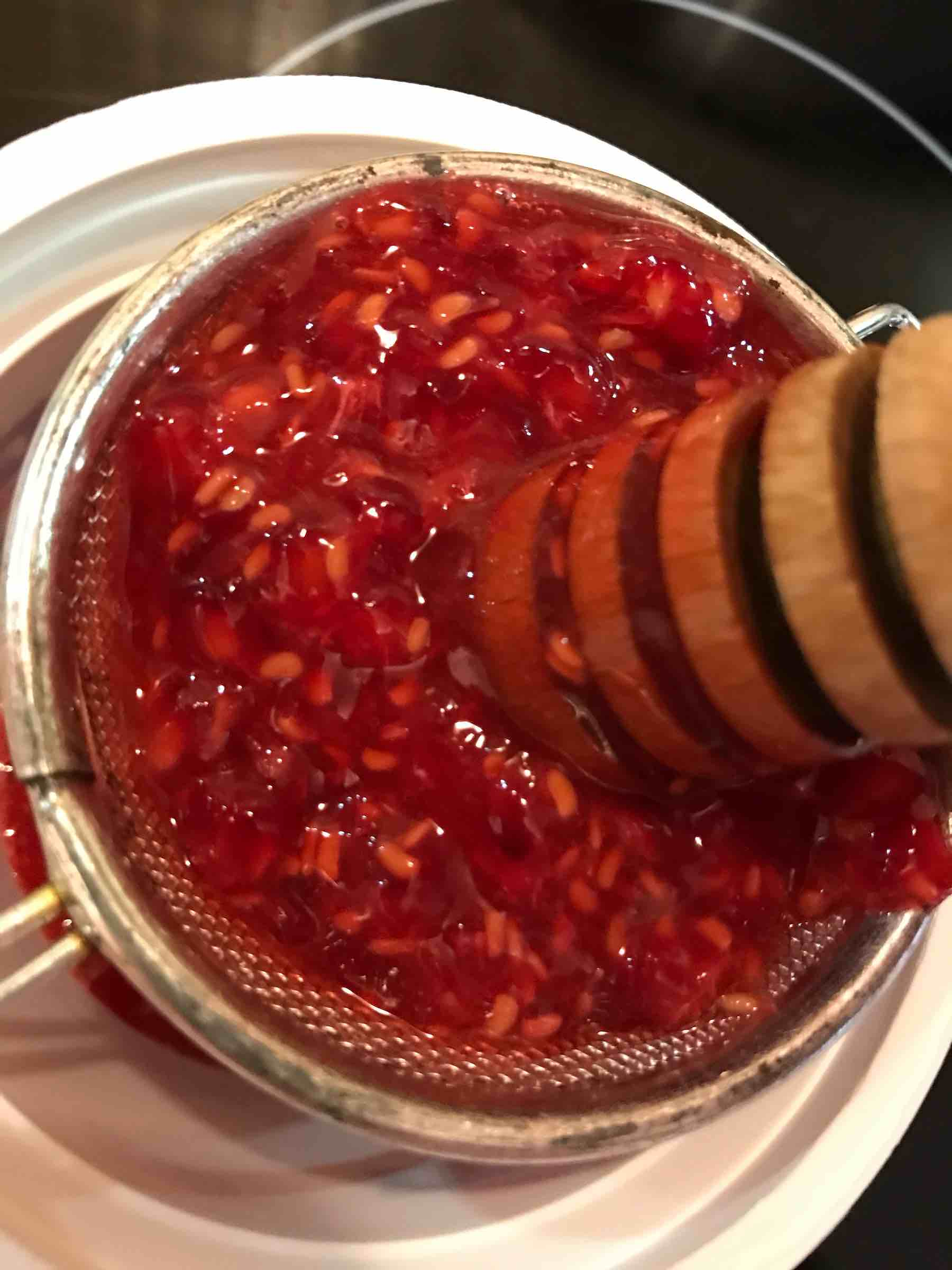 Raspberries being mashed